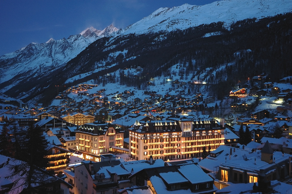 Skiing in the Alps - Mont Cervin Palace at Night in Zermatt