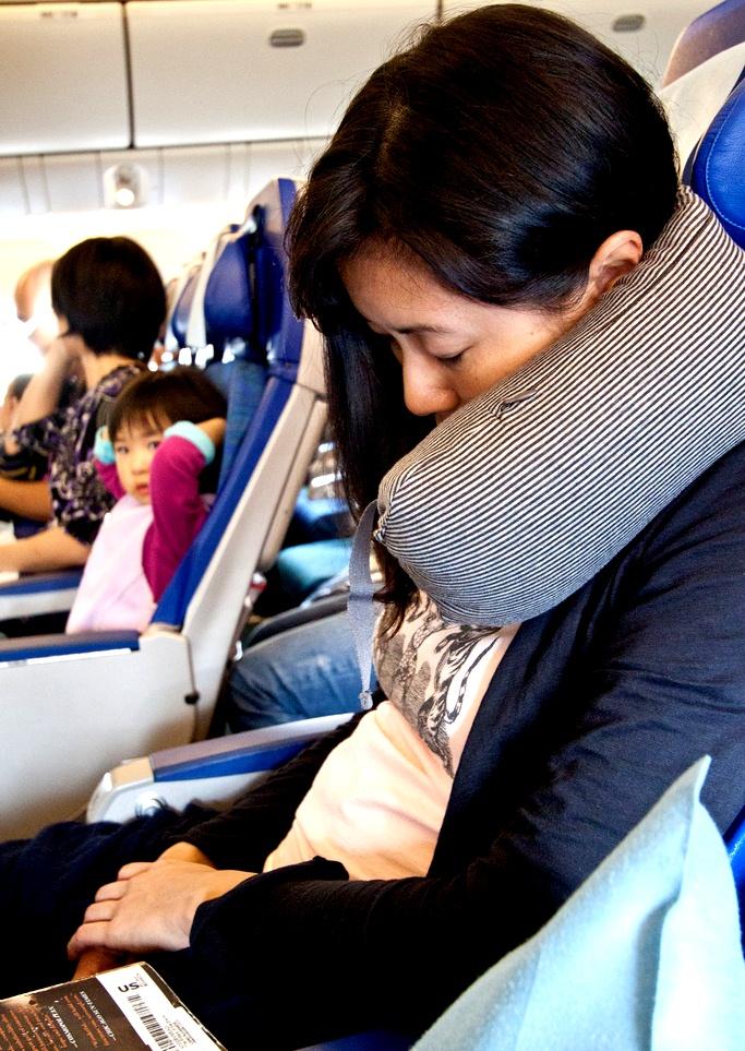 Best Travel Pillow - Passenger Sleeping